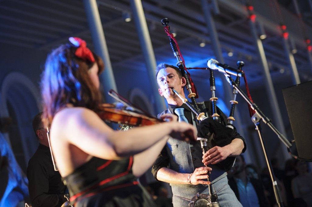professional bagpiper in modern ceilidh band