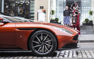 bagpiper, car launch, VIP, supercar